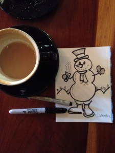Snowman drinking a latte